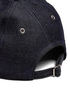 Minimally cool staples are intrinsic to APCs aesthetic This indigoblue Louis baseball cap is expertly crafted from Japanese denim thats accented with matte silvertone met.