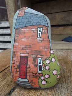 The painted pebbles are proving very popular at the moment : red brick house