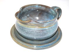 **ORDER MADE NOW ARE EXPECTED TO ARRIVE AFTER CHRISTMAS** If you want something before 12/25 please message us to check availability. Custom glazes and dinnerware sets take 4-6 weeks. -------------- Twilight Gravy Boat  Size: 3 H 5 1/2 W  COLOR:Twilight [All glazes are custom made in the studio]  Description: This listing is for one 16 oz. Gravy Boat and one Small Plate to catch the drips. All of our stoneware pottery is for functional use. It is LEAD FREE; microwave, dishwasher and...
