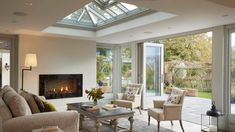Cosy orangery with sitting area and fireplace