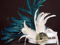 Tahitian side headpiece. White fabric base with gray trim and freshwater pearls and an xlg abalone shell.