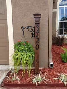 Address sign with a planter. Great idea