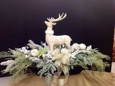 Reindeer in basket with Christmas foliage by Andi (9989)