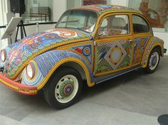 A Beetle decorated in the Huichol style of beading now on display at the Museo de Arte Popular in Mexico City
