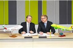 Brian LaBelle, Senior Vice President of Emirates Skywards (left) and Anton Eremin, Deputy CEO of the S7 Group sign the partnership agreement between both airlines.