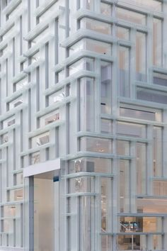 Corner facade of the Coach Omotesando flagship store, Japan by OMA