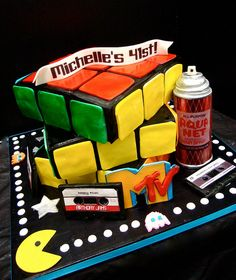genius 1980s themed cake from Debbie Does Cakes...someone needs to give me this for my 40th...