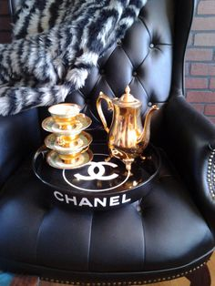 CHANEL 15in. round tray with built in handles. Made of melamine