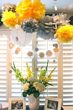 Bridal shower decor in front of beautiful white plantation shutters.