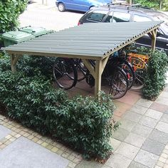 Would like to know about shed plans? Then this is without doubt the right place! Garden Bike Storage, Outdoor Bike Storage, Outdoor Spaces, Outdoor Living, Outdoor Decor, Garage Velo, Linden Homes, Bike Shelter, Hillside Landscaping