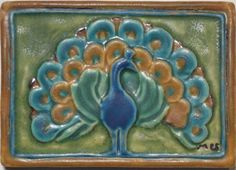 Pewabic's handpainted full-fanned peacock tile dates back to 1909 and is the only piece known to be signed by founder Mary Chase Stratton. Her initials can be found in the lower right corner of the tile. Each tile is signed on the back by the artisan who painted it. $71.95