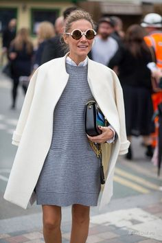 Grey mini dress with a cream coat and statement sunnies.