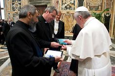 Pope Francis launches the smartphone app Missio during an audience with national directors of pontifical mission societies May 17 at the Vatican. CNS photo/L'Osservatore Romano via Catholic Press Photo