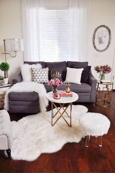 Fresh flowers and plants are a must to lift the mood of a room to light and bright. These topiaries from HomeGoods mixed with live plants and fresh flowers have me thinking of spring and warmer days. Bright white faux fur accessories create a cozy vibe. Sponsored by HomeGoods