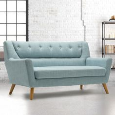 The most noticeable element of the Lambeth Large Duck Egg Blue Fabric Sofa is without doubt the button detailing on the backrest. This understated row of seven little buttons adds immediate visual appeal and a nod towards the classic sofa styles of yester Blue Furniture Living Room, Classic Sofa Styles, Sofa, Duck Egg Blue Fabric, Furniture, Seater Sofa, Cheap Leather Sofas, Retro Sofa, Blue Fabric Sofa