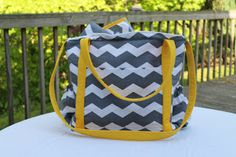 Love the bright yellow with the chevron pattern. It has a ton of storage too!