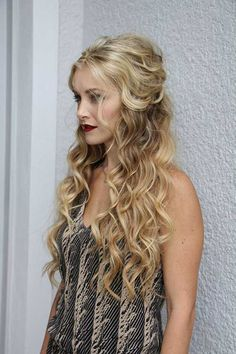 Exquisite!! These promfect curls pulled into a half up hairdo is elegant and gorgeous!!