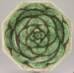 """Octagonal creamware plates with polychrome cabbage leaf decoration, beaded molded edges, 9"""" diameter. Probably French, circa 1790."""