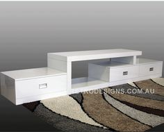 White gloss TV cabinet In step design with rug in brown abstract design. Tv Console Modern, Modern Tv Cabinet, Cabinets For Sale, Tv Cabinets, White Entertainment Unit, White Tv Cabinet, White Tv Unit, White Tv Stands, Modern Tv Units
