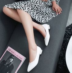 Loving the front detail from these white flats with a small chunky heel! Perfect to wear with a dress, skirt or jeans.