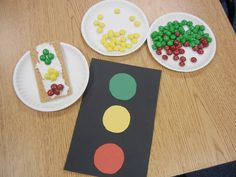Our theme was transportation/traffic lights and we made edible traffic lights in class today!  Kids loved them!  Next time I will color the frosting black.