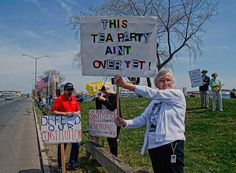 Protesters make their voices heard during a Tax Day Tea Party rally held by the Connecticut Tea Party Patriots along Long Wharf in New Haven . Photos- Peter Casolino/New Haven Register 04/15/12