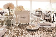 glittery silver linens + framed table numbers | Brooke Mayo