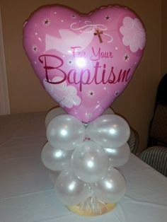 Baptism centerpiece like me on Facebook Rosielloons