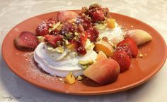Fruity Meringue Nests sprinkled with crushed Pistachio pieces (Strawberry, Raspberry, Apricot & Peach)