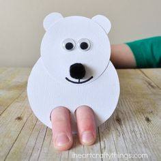 When the weather gets cold and snowy my daughter always gets out some of her favorite books about Polar Bear's at bedtime. She has a favorite called <em class=short_underline>  Polar Babies </em> (affiliate) and reading it always gets us in the mood for a fun <em class=short_underline>  Polar Bear craft </em>. These cute <b>  Polar Bear Finger Puppets </b> are not only a great <b>  winter kids craft </b> but they are perfect combined with a favorite children's book abou...
