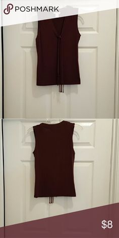 Brown Sleeveless Top Chocolate Brown Sleeveless Top with cross tie fringes on front. Been worn Great for cooperate wear in good condition... Tops Blouses