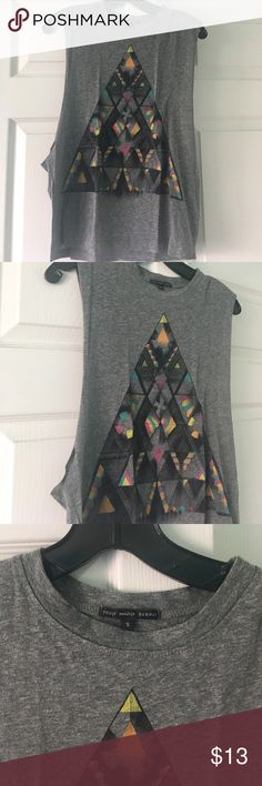 PRICE DROP! Urban Outfitters Graphic Muscle Tank Muscle tank top from Urban Outfitters in size small. Only worn a couple times! In great condition. Open to offers! Bundle with other tank top! Urban Outfitters Tops Muscle Tees