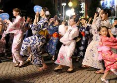 """Dancing like fools"" at the Bon Odori festival in Tokyo"