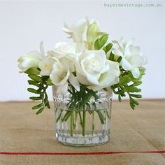 White roses and freesias in a French vintage jam pot with French jute linen cloth. Simplicity is best! www.baysidevintage.com.au
