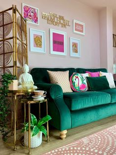 Green velvet sofa looks fab against pink wall painted in Delicate Blossom