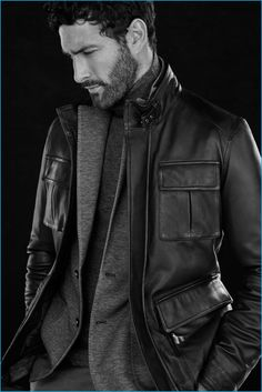 Appearing in an editorial for Massimo Dutti, Noah Mills wears a leather field jacket with a sport coat and turtleneck sweater.