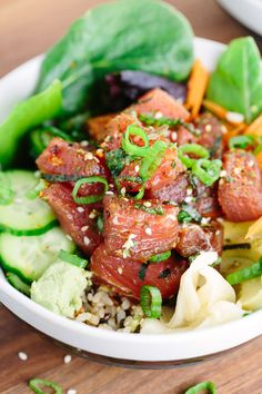 Ahi Tuna Poke Bowl - This Japanese recipe is loaded with healthy brown rice, salad, vegetables and topped with marinated tuna poke.