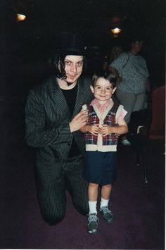 Jack White and a tiny fan.  Aren't they adorable?