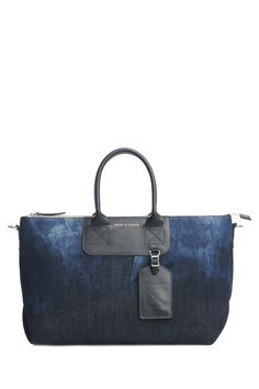 Graf & Lantz Bedford Indigo Denim Crosstown duffle Tote Bag. Clean Washed denim with Black leather contrast trim. Cool forward style with clean lines. Hand crafted in our Los Angeles studio. $395