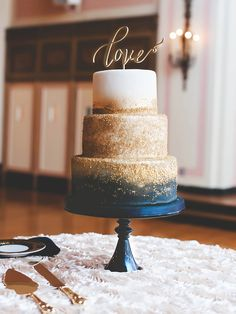 A black ombre and gold glittered cake is Halloween wedding goals! The non-traditional take on a three-tiered cake is the perfect touch to your fall wedding. Navy Blue Wedding Cakes, Metallic Wedding Cakes, Purple Wedding, Wedding Cakes With Gold, Navy Blue And Gold Wedding, Copper Wedding, Glitter Wedding, Wedding White, Cake Toppers