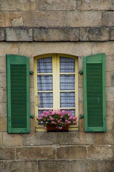 green shutters, pink flowers, yellow window frame