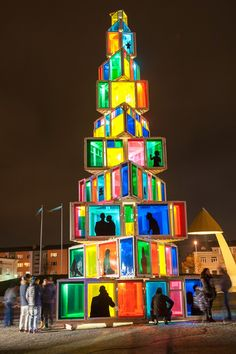 This colorful tree really takes repurposing to the next level—it's made from 121 old windows from local old houses. - TownandCountryMag.com