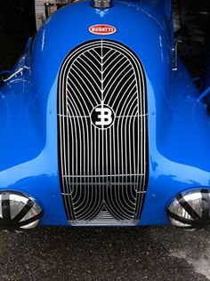 The Bugatti was unveiled in Paris in 1991 and went into production until Bugatti went out of business in 1995 (Bugatti has since been resurrected by Volkswagen). The car was available as a two-door sports car and only 31 cars were produced. Vintage Racing, Vintage Cars, Tricycle, Automobile, Car Badges, Bugatti Cars, Concours D Elegance, Best Classic Cars, Hood Ornaments