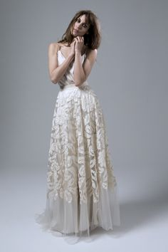 This week, our featured wedding dress is the unique Susie skirt worn over the elegant Iris slip. The tulle Susie skirt is a real piece of art and features hand appliqués which really stand out on top of the bias cut Iris slip.   The backless detail creates an alluring feel and the simplicity of the spaghetti straps perfectly balances the detailed skirt.