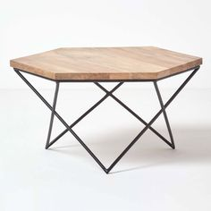 Natural wood geometric coffee table, handcrafted from solid mango wood, with a black cast iron metal frame. This industrial style furniture hexagon coffee table measures 40 cm tall. Industrial Coffee Table A unique geometric style coffee table, with a h Hexagon Coffee Table, Iron Coffee Table, Steel Furniture, Living Furniture, Table Furniture, Industrial Style Furniture, Contemporary Furniture, Wooden Tops, Wood And Metal