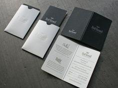 Business card (designed by 3 Advertising) repurposes the folding menu format in miniature as a business card, complete with it's own mini envelope for presentation.  Awesome.