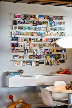I have this white shelf from ikea hung high as a book shelf, but love the look of it hung lower like a console table.