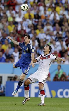 Argentina's Lionel Messi, left, and Germany's Mats Hummels go for an header during the World Cup final soccer match between Germany and Argentina at the Maracana Stadium in Rio de Janeiro, Brazil, Sunday, July 13, 2014.