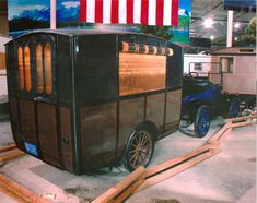 1913 Earl Trailer and Model T Ford --  Believed to be the oldest non-tent travel trailer in existence.