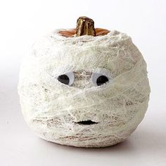 12 DIY Halloween ideas -- the mummified pumpkin is a cute idea for quick and non-messy decoration